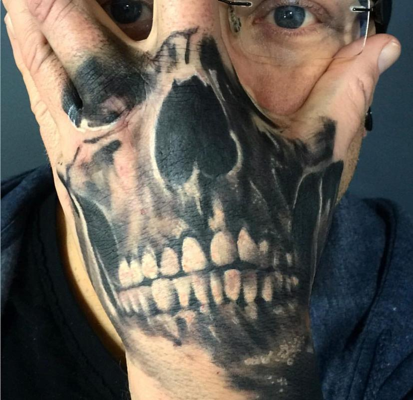skull hand tattoo shop duluth mn by kyle grover tattoonow. Black Bedroom Furniture Sets. Home Design Ideas