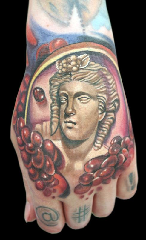 Woman 39 s profile brooch w pomegranate seeds by max egy for Tattoo shops terre haute indiana