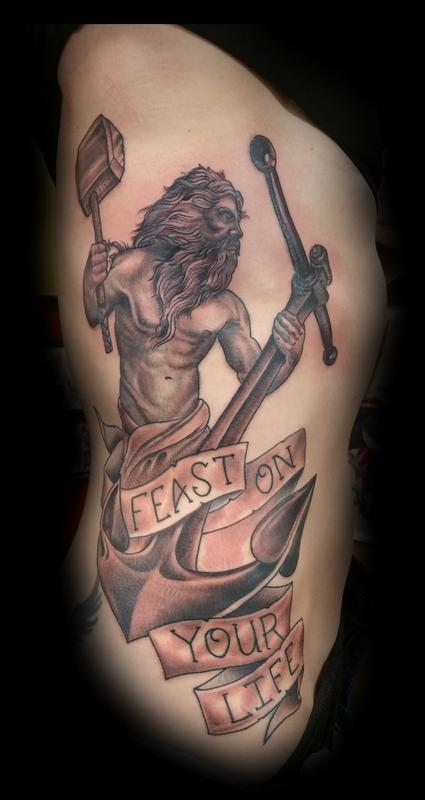 Black and grey hephaestus with anchor by glenn collins for Tattoo shops belgrade mt