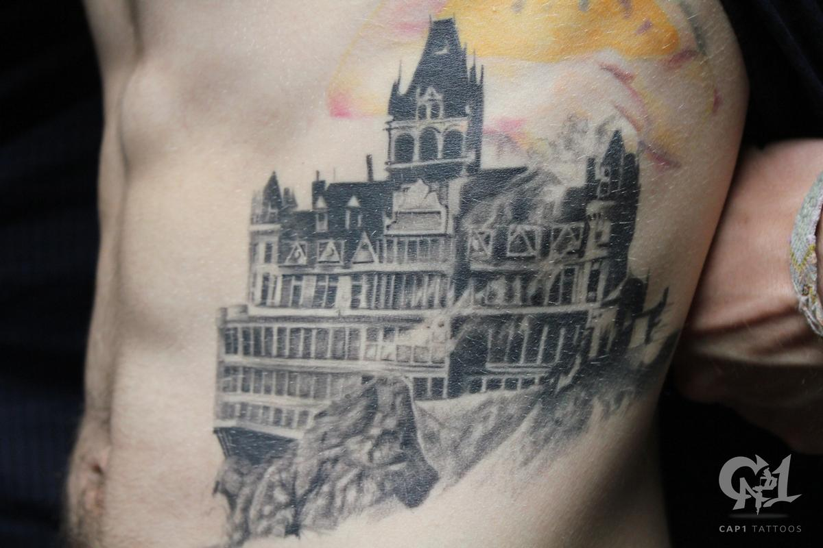 Burning cliff house tattoo by capone tattoonow for Tattoo shops denton tx