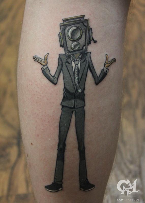 Camera man tattoo by capone tattoonow for Tattoo shops denton tx