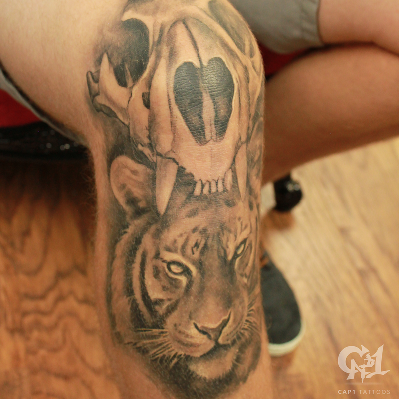 Tiger skull and tiger knee tattoo by capone tattoonow for Tattoo shops denton tx