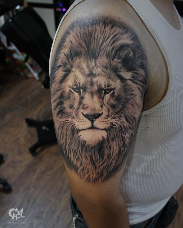 Realistic lion tattoo by capone tattoonow for Tattoo shops denton tx