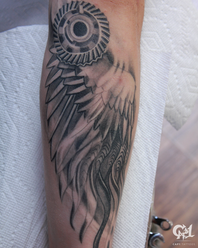 Mechanical wing tattoo by capone tattoonow for Tattoo shops denton tx