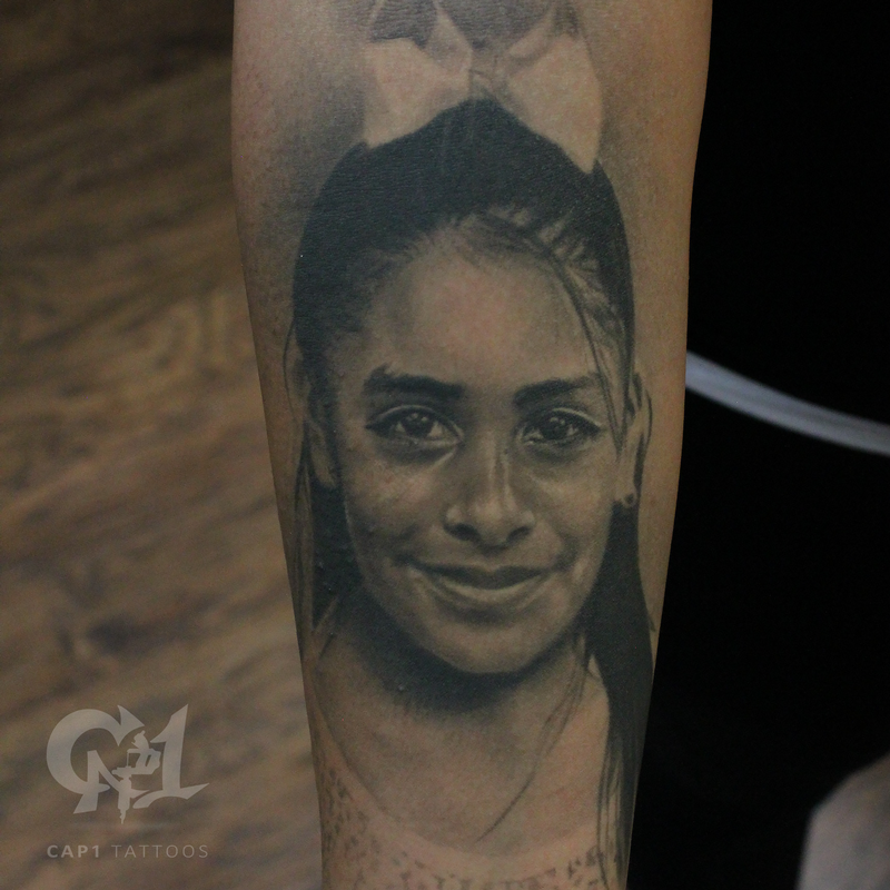 Photorealistic girl portrait by capone tattoonow for Tattoo shops denton tx