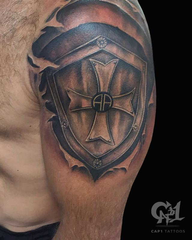 Skin rip shield tattoo by capone tattoonow for Tattoo shops denton tx