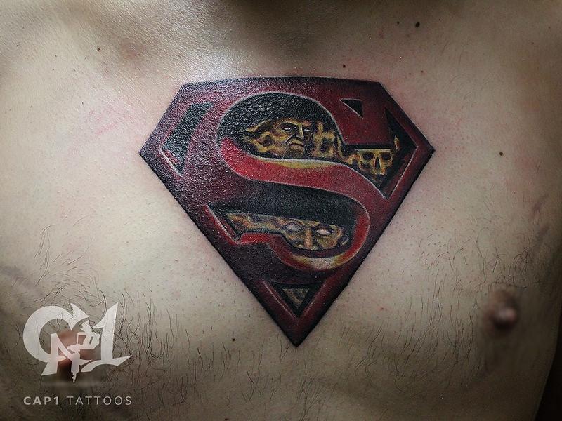 Superman by capone tattoonow for Tattoo shops denton tx