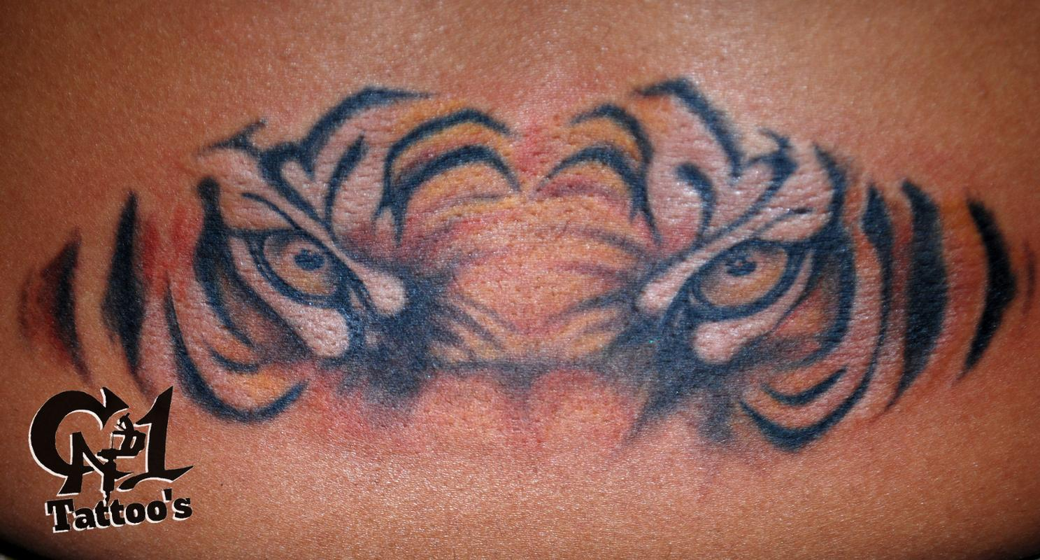 Tiger eyes tattoos lower back - photo#5