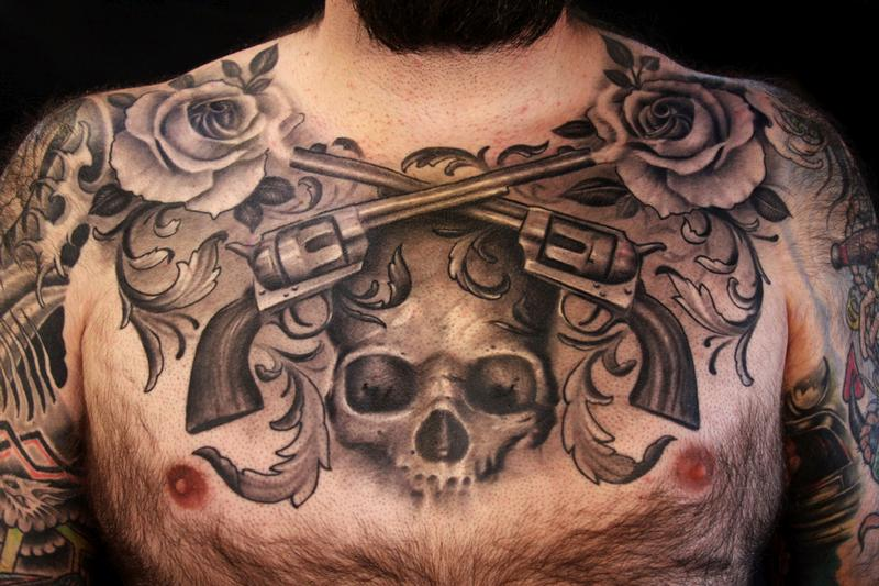 black and grey chest piece by Cory Norris: TattooNOW :