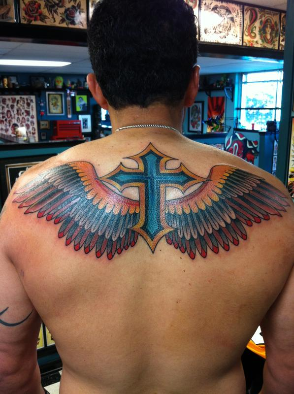 The eagle was busy cross had to fill in by william for Black eagle tattoo shop
