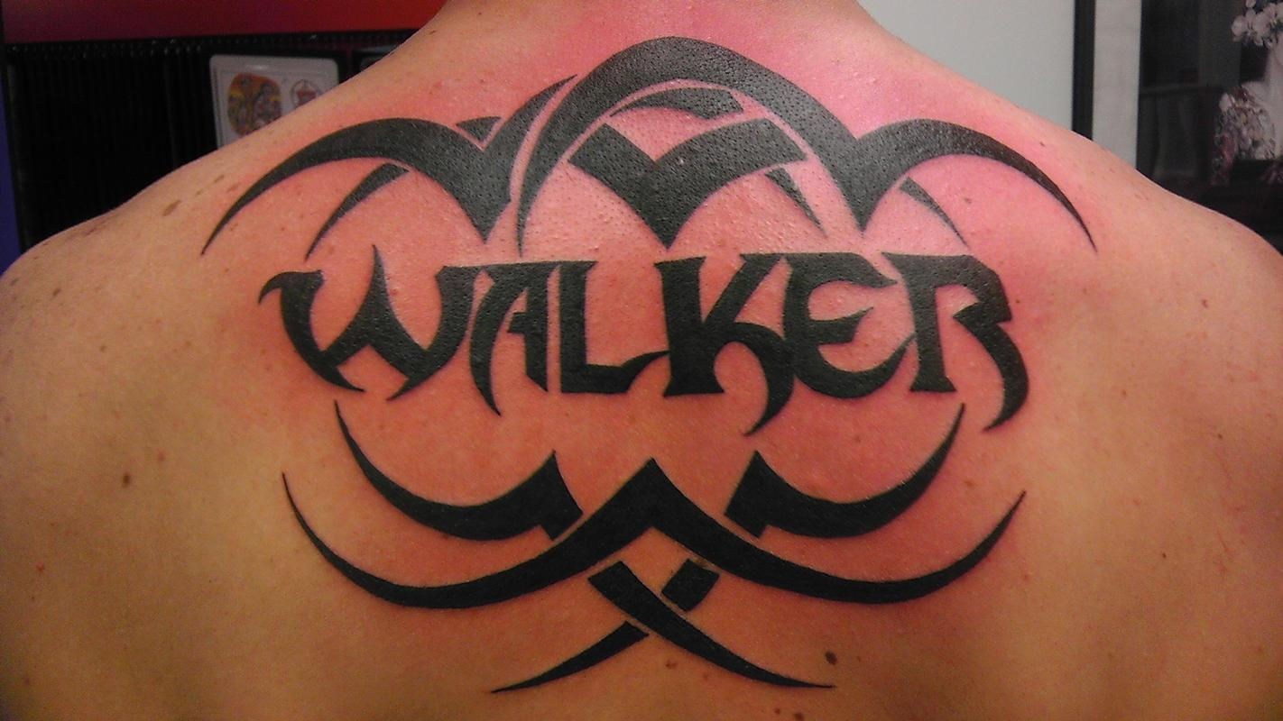 Tribal with last name by jon fallows tattoonow for Last name tattoos on back