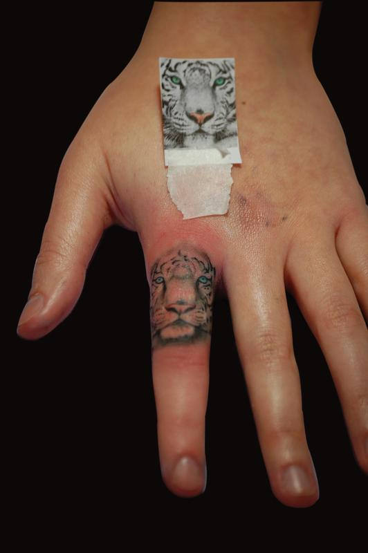 White tiger by jordan campbell tattoonow for Animal finger tattoos
