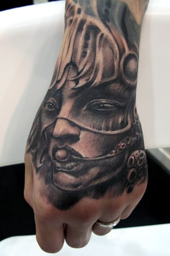 Asian female face on hand by little dragon tattoonow for Asian face tattoos