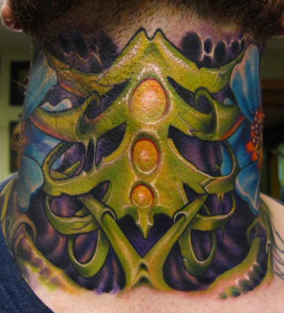 Biomech rib cage throat tattoo by scotty munster tattoonow for Tattoo shops in st cloud mn