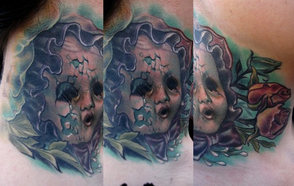 Cracked doll head with roses neck tattoo by scotty munster for Tattoo shops in st cloud mn