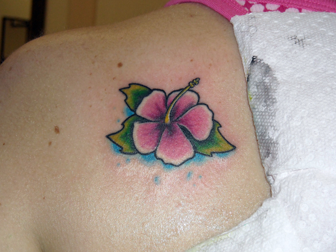 Small cartoon hibiscus by mark manley tattoonow for Small cartoon tattoo designs