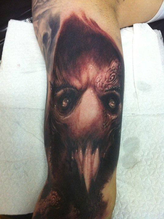 Evil face tattoo by tommy lee wendtner tattoonow for Evil faces tattoos
