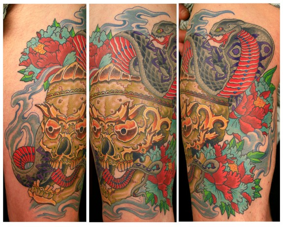 Tibetian skull and cobra thigh piece by canman tattoonow