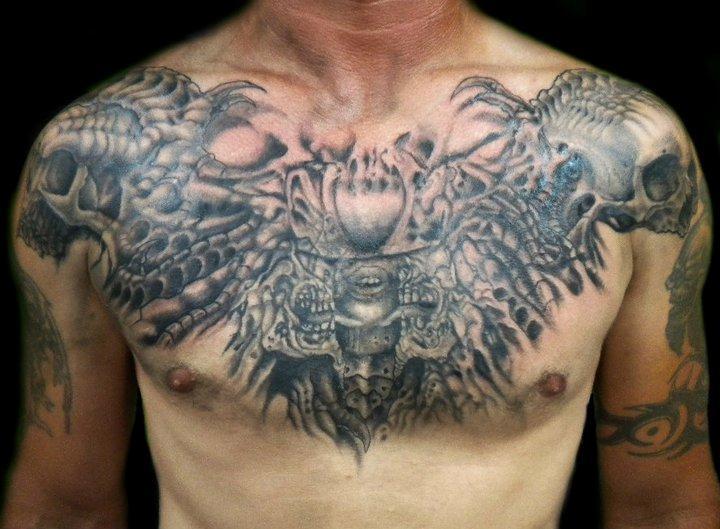 Bird head tattoo 25 elegant tattooed breasts for Chest tattoo prices