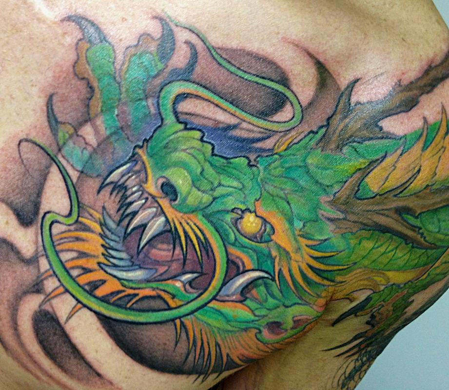 Dragon chest plate by mike boissoneault tattoonow for Chest plate tattoos